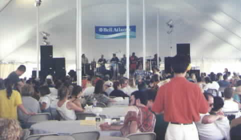 Andy Kimbel performing to  to large crowd at Blues Festival